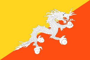 """I Bhutan skjuter """"Åskdrakens folk"""" (draken syns på landets flagga) med pilbåge, dansar iklädda färgglada masker och dräkter. De vördar Buddha – och kanske ännu mer Druk Gyalpo, sin egen """"drakkung"""". ©Wikimediacommons"""