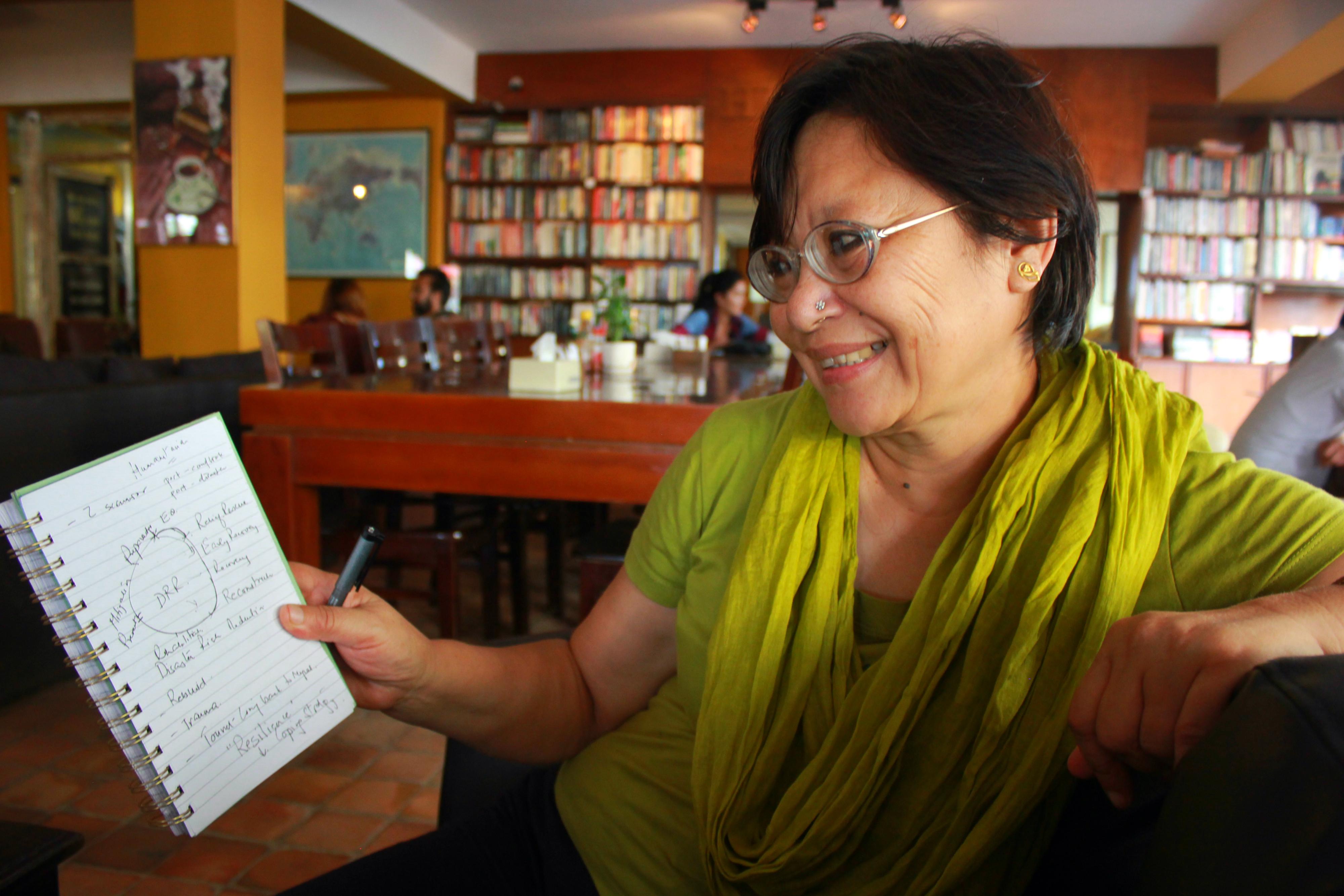Megh Ranjani Rai var själv en av de drabbade i jordbävningen. Det dröjde över ett år innan hon kunde flytta tillbaka in i sitt hus som förstördes i skalvet. Foto: Celia Boltes
